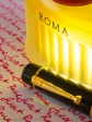 The Cap of the Montblanc Dumas-Pen together with a parfume flacon